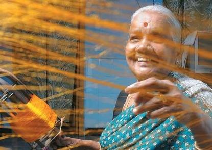 Woman weaving silk saree